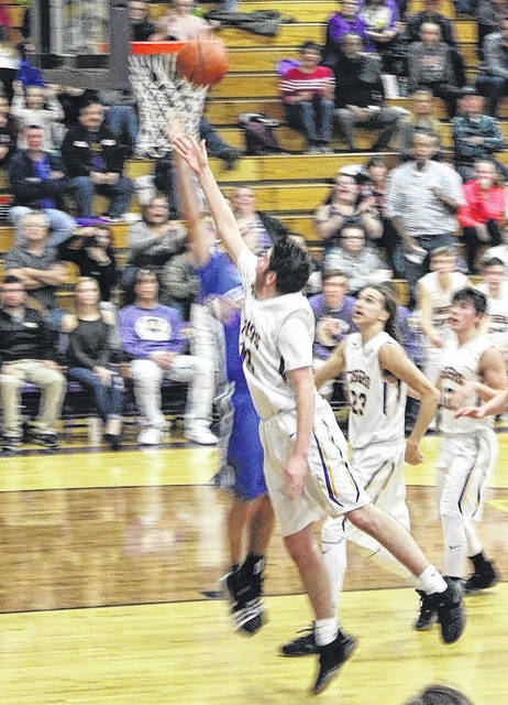 Devin Carter shoots a layup with a Chillicothe defender on his hip on Friday at McClain High School in FAC basketball action.
