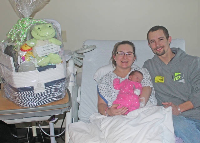 Parents Caleb and Kristen Chaney hold Nova Chaney, 2018's first baby born Monday morning at Adena Regional Medical Center.