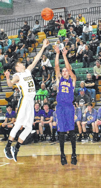 Landry Gray shoots a jumper over the outstretched hand of a North Adams defender on Saturday night during the final game of the Coach Young Classic at North Adams High School.
