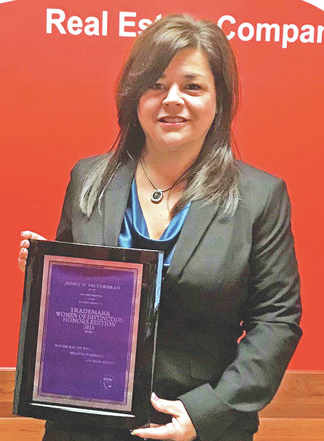 Jenny Hilterbran is pictured with a plaque she received for being included in the Trademark Women of Distinction Honors Edition.