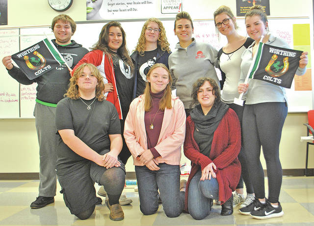 Hillsboro High School students are pictured Friday in Mindy Lawson's classroom holding a couple of the gifts they received after delivering Christmas presents to students at Worthing High School in Houston, Texas. Front row from left are Gideon Pickering-Polstra, Rebecca Rust and Andrea Archie. Back row from left are Zebadiah Pickering-Polstra, Alexandra Martinez-Mendez, Faye Wooden, Sydney Sears, Annaliese Fite and Emma Horick.