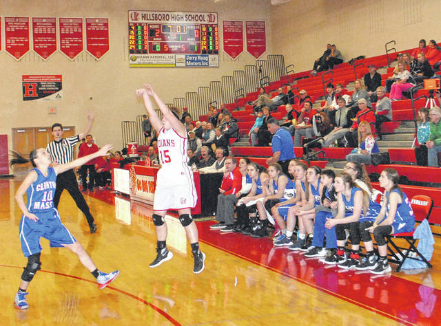 Lana Grover shoots a three point jump shot over the outstretched hand of a Clinton-Massie defender as the Lady Falcon's bench looks on early in the first quarter at Hillsboro High School on Tuesday.