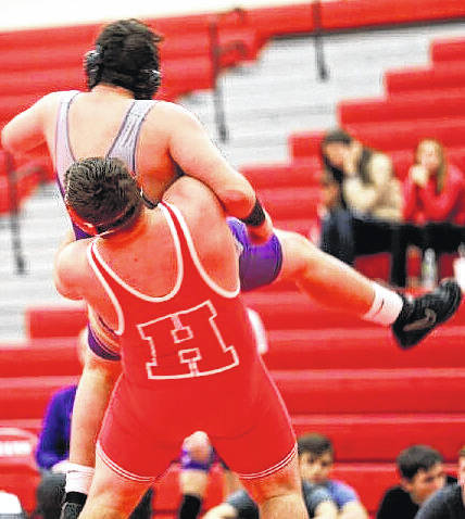 Hillsboro's heavyweight wrestler, Lane Cluff, wins by a pin fall over McClain's Kai Borrelli. This brings Cluff's record to 32-3 for the season.