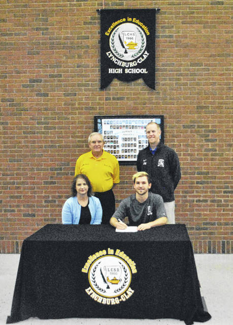 Kyle Luneke signs a letter of intent to play soccer for Ohio Christian University. Front row (l-r): Jill Luneke (Mother) and Kyle. Back row (l-r) Dennis West (Mustangs head coach) and Josh Murton (OCU head coach).