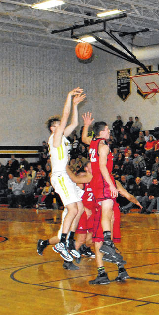Lynchburg's Eric McLaughlin shoots a jumper over two Eastern defenders on Friday at Lynchburg-Clay High School in SHAC basketball action.