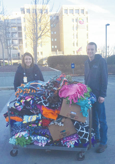 On Dec. 21, Mowrystown FFA member Cole Pharo delivered 93 blankets and 217 towel bears from the Day Of Giving to Cincinnati Children's Hospital. The chapter would like to thank Hillsboro FFA Alumni member Minnie Price for helping deliver the blankets and bears.