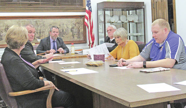 Greenfield School Board member Sandy Free (far left) talks to board members about tile choices for the high school at Wednesday's school board meeting. Also pictured (clockwise from Free) are board member Jason Allison, board president Eric Zint, district treasurer Joe Smith, and board members Marilyn Mitchell and Charley Roman.