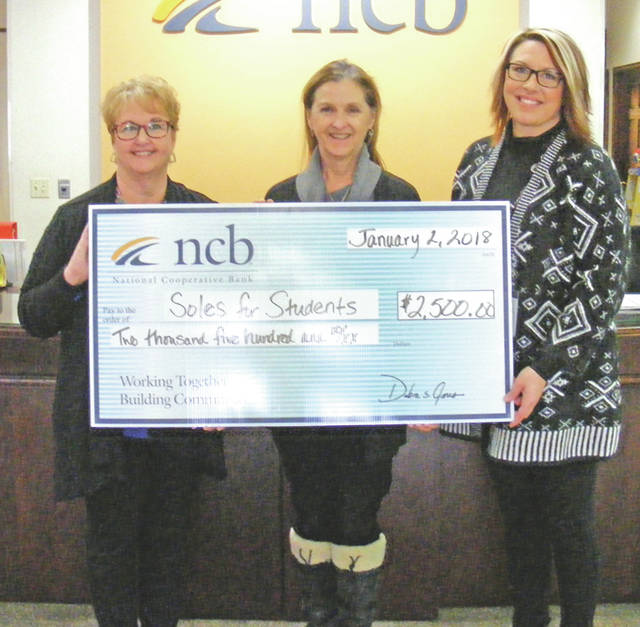 NCB recently donated $2,500 to Soles for Students. Through cooperation with the local schools, school counselors can verify a child that is in need of shoes. This program has purchased more than $11,000 in shoes for students in Highland County. Pictured, from left, are NCB Vice President Tammy Irvin, Soles for Students founder Sue Davis and NCB Branch Manager Jocelyn Leeth.