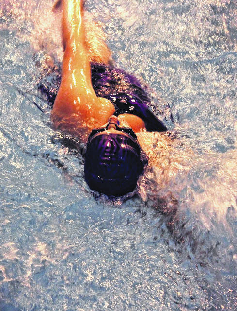 Hailey Rhoades swims in the mixed 50-meter backstroke on Wednesday at McClain High School where the middle school Tigers Sharks hosted Portsmouth.