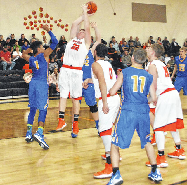 Zach Rand is fouled in the third quarter as he attempts a layup over several Manchester defenders on Monday at Whiteoak High School.