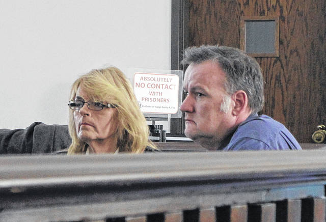 Tina Bryant, left, and Virgil Bryant, right, sit in Highland County Common Pleas Court during their sentencing hearing Wednesday.