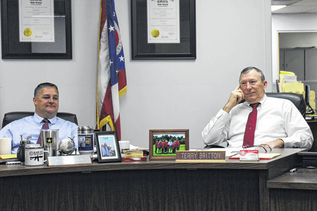 Highland County Commissioners Shane Wilkin, left, and Terry Britton hear discussion on Wednesday during a commissioners meeting.
