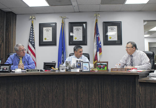 From left, Highland County Commissioners Jeff Duncan, Shane Wilkin and Terry Britton discuss business items during a Wednesday commissioners meeting.