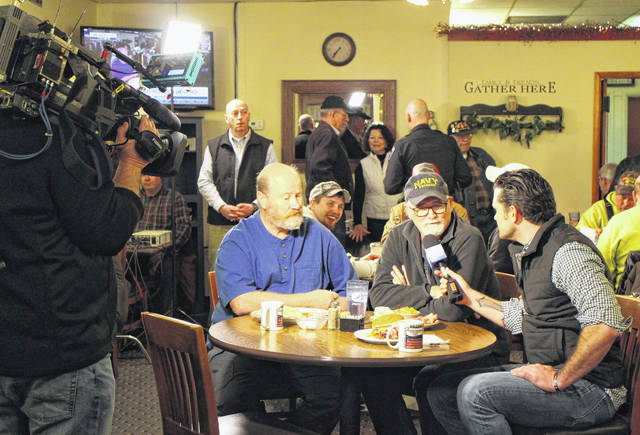 """Fox host Pete Hegseth, right, interviews local veterans Dennis Griffith, left, and Rob Moffat during Wednesday's """"Fox & Friends"""" visit to Momma's West Main Cafe in Hillsboro."""