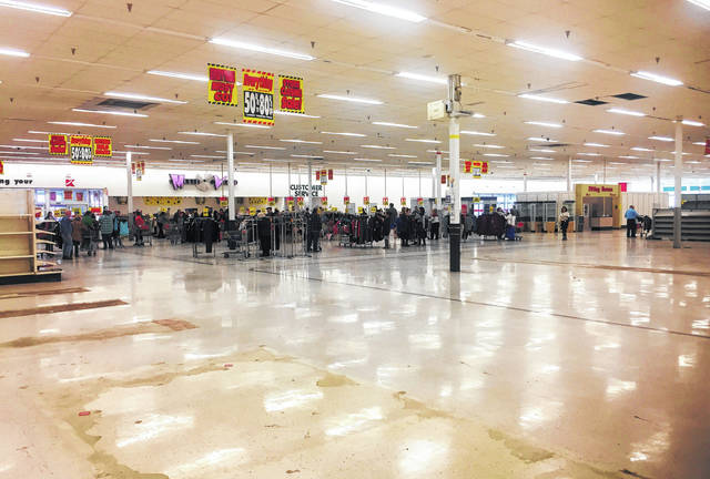 Most corners of the store were empty Sunday as remaining merchandise at Hillsboro's Kmart was gathered near the checkout lanes as customers looked for big savings during the retailer's final day of operation here.