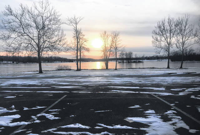A peaceful and picturesque sunset earlier this week at Rocky Fork Lake heralded warmer temperatures for a couple of days, but ice and snow were predicted for Friday into Saturday morning, along with plummeting temperatures into next week.