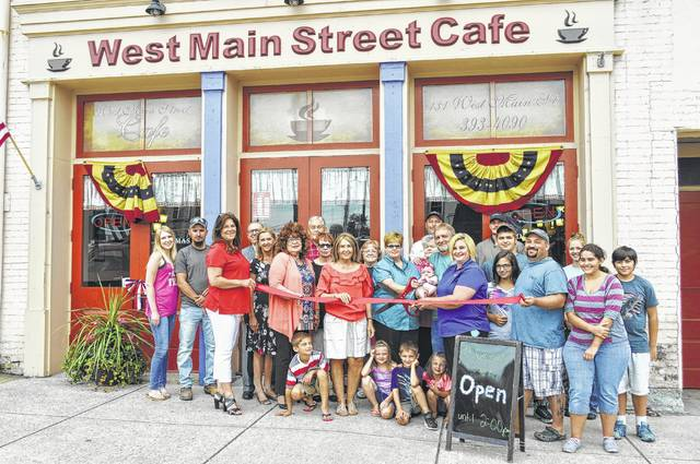 """Shown are participants in a ribbon-cutting ceremony last summer celebrating the opening of Momma's West Main Street Cafe in Hillsboro. The restaurant will be hosting """"Fox & Friends"""" on Jan. 17."""