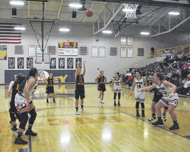 Lynchburg-Clay's Abby Blankenship shoots the second of two free throws late in the fourth quarter in an attempt to tie the game against the Eastern Lady Warriors on Saturday at Valley High School during the Division III girls Sectional Championship game.