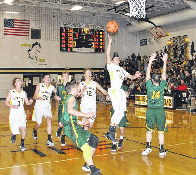 In this photo from a January 26 game at home against the North Adams Green Devils Austin Hilt of Lynchburg-Clay attempts a floater after beating the defense off the dribble. Lynchburg-Clay advanced to the Sectional Final game on Saturday, February 24, at Waverly High School with a 78-68 win over Adena on Wednesday.