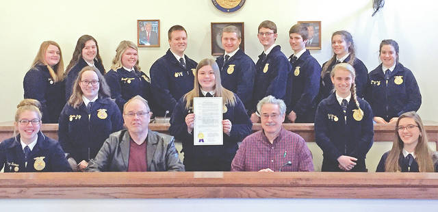 On Tuesday, Feb. 13, Phil Clyburn (front, left), Greenfield Village Council chairmen, signed a proclamation declaring Feb. 19-25 National FFA Week. The McClain FFA officers and Ron Coffey, city manager, also attended the signing.