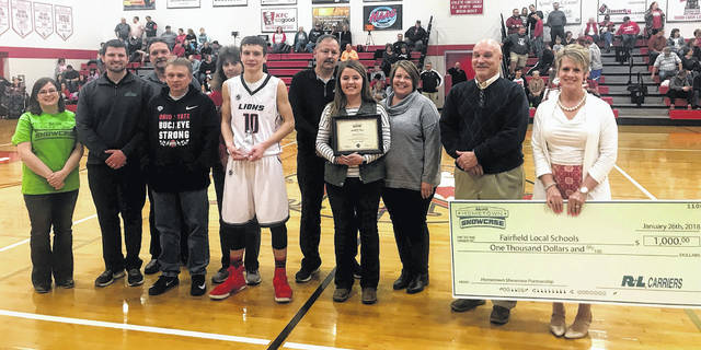 During a ceremony at halftime of the Fairfield varsity basketball game R&L Carriers awarded seniors Makenna Lane and Cody Gragg. Pictured (l to r): Christina Beatty (R&L rep), Dane Gordon (R&L rep), Jody Gragg (Cody Gragg's father) Bill Garrett (superintendent), Angie Gragg (Cody Gragg's mother),Cody, Drue Lane (Makenna Lane's father), Makenna, Heather Lane (Makenna's mother), Steve Hackett (FHS Principal) & Denise Mootz (FHS A.D.).
