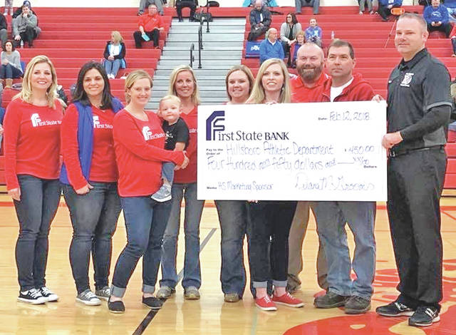 Members of the First State Bank team are pictured with Hillsboro High personnel including, from right, boys basketball coach Bruce Miles, girls basketball coach JR Moberly and athletic director Dave Dietrick.