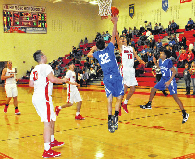 Hayden Haines attempts a layup over a Chillicothe defender in the fourth quarter of the Cavaliers 67-38 win at Hillsboro High School on Friday.