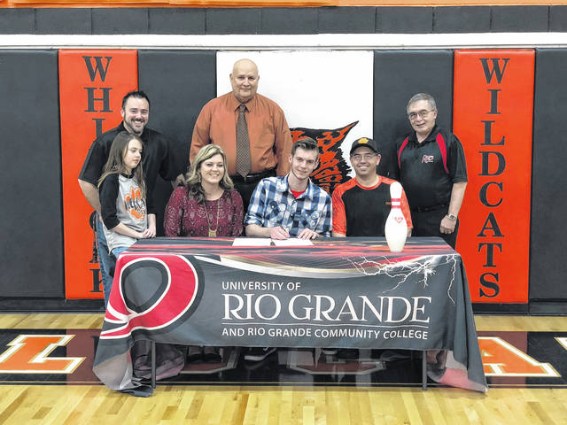 Shane Elliott a senior from Whiteoak High School has signed to bowl at the University of Rio Grande next year. Pictured front row (l-r): Madison Davidson, Shauna Davidson, Shane Elliott and coach Charles Nace. Back row (l-r): Michael Davidson, Superintendent Ted Downing and Rio Grande coach Phil Karl.