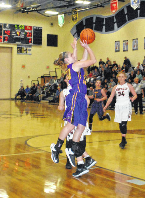 Lady Tiger junior Kelli Uhrig shoots a short jump shot after beating two Waverly defenders off the dribble Monday night at Adena High School in a sectional play-in game.