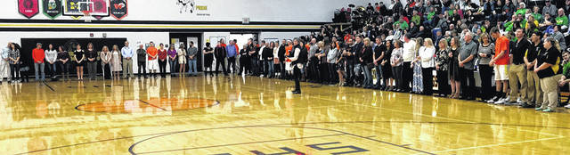 Lynchburg-Clay seniors line the perimeter of the court on Friday at Lynchburg-Clay High School as the Mustangs honor them prior to their game against West Union.