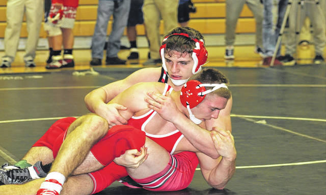 Hillsboro's Mason Stanley grapples with Jackson's Brice Parks during their match at 160 pounds Saturday at Miami Trace High School as part of the inaugural FAC wrestling tournament.