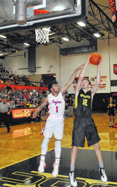 Lynchburg-Clay's Eric McLaughlin jumps to dunk the ball in transition on Saturday at Waverly High School where the Mustangs were battling the Portsmouth Trojans for the D III Sectional Title.