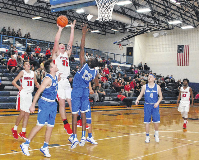 Phil MyCroft puts up a layup attempt over two Washington defenders on Tuesday at Southeastern High School during the second half of the Indians and Blue Lions Sectional Semi-Final game.