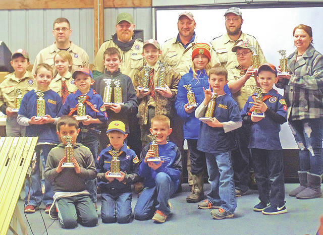 Members and leaders are of Hillsboro Cub Scout Parck 37 are pictured with trophies they won at the annual Pinewood Derby.