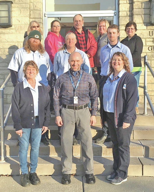 New Greenfield Postmaster Brian McNeal (front, center) is pictured with his staff (front row, l-r) clerk Jenny Howland, McNeal and clerk Christy Barnhart; (middle row, l-r) city carriers Cody Hufford, Jennifer Lowe and Luke Anderson; (back row, l-r) rural carriers Becky Foy, Kay Campbell, Mike Thompson, Debbie Shock and Sarajayne Lawwell. Not pictured are Tim Case and Michael Hottle.