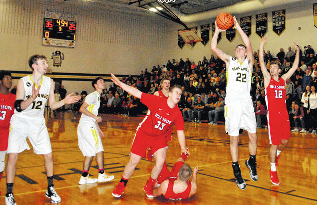 Raymond Conner of Lynchburg-Clay attempts a layup following a post move on Hillsboro's Phil MyCroft that left him on the ground on Tuesday at Lynchburg-Clay High School.