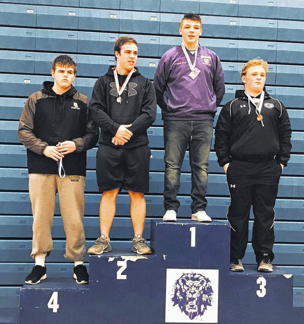 McClain freshman Kade Rawlins (third from the left) is pictured atop the podium as the champion of the 220 pound weight class at the Washington High School Bracket Tournament in Washington Court House on Saturday.