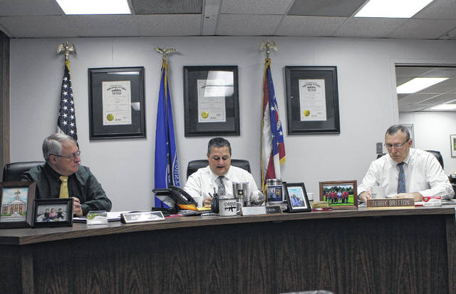 From left, Highland County commissioners Jeff Duncan, Shane Wilkin and Terry Britton sit in session during a commissioners meeting Wednesday.