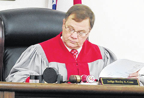 Judge Rocky Coss reviews paperwork while on the bench in Highland County Common Pleas Court.