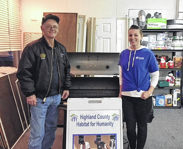 Shown is Hillsboro resident Chuck Emery, left, and Highland County Habitat for Humanity Executive Director Elishia Breetz. Emery recently won a grill/smoker as part of a Habitat fundraiser.