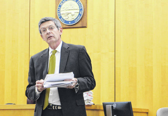 Hillsboro Municipal Court Judge David McKenna speaks to those in attendance at a ceremony honoring nine men who completed the court's Vivitrol program.