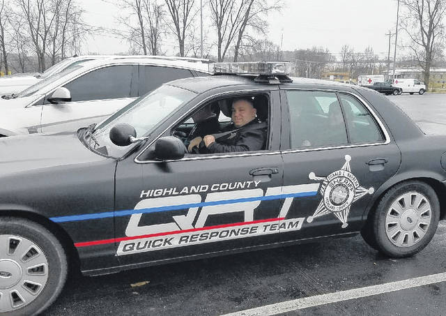 Highland County Sheriff's Deputy Mike Gaines rolls out Wednesday morning with Quick Response Team members in the group's special cruiser.