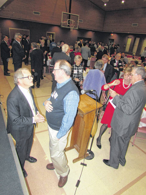 Ohio Attorney General Mike DeWine, left, talks with local auctioneer Rick Williams as county Auditor Bill Fawley, right, talks with DeWine's wife, Fran, at Monday night's Lincoln Day Dinner in Hillsboro. DeWine is seeking the GOP nomination for governor.