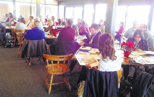 Local government officials, Rocky Fork Lake area business owners and others are shown at an initial meeting in December 2014 at the Overlook Retreat Banquet Center as efforts got underway to pursue a Justice Department grant to fight crime and improve the lake area. After the $844,000 grant was awarded in October 2016, local and federal officials have been frustrated that the grant dollars have not been released for reasons which have yet to be fully explained.