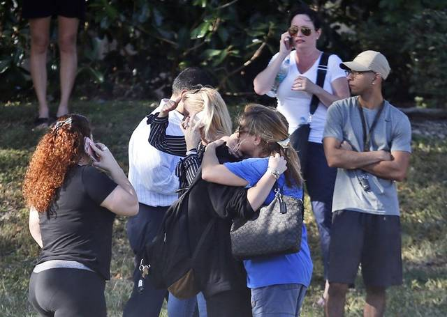 Anxious family members wait for news after a Florida school shooting. (AP photo)