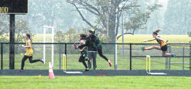 In this file photo Lynchburg-Clay senior Abby Blankenship, far right, clears a hurdle on the backstretch on the Lynchburg-Clay High School track at the 2017 Lynchburg Invitational.