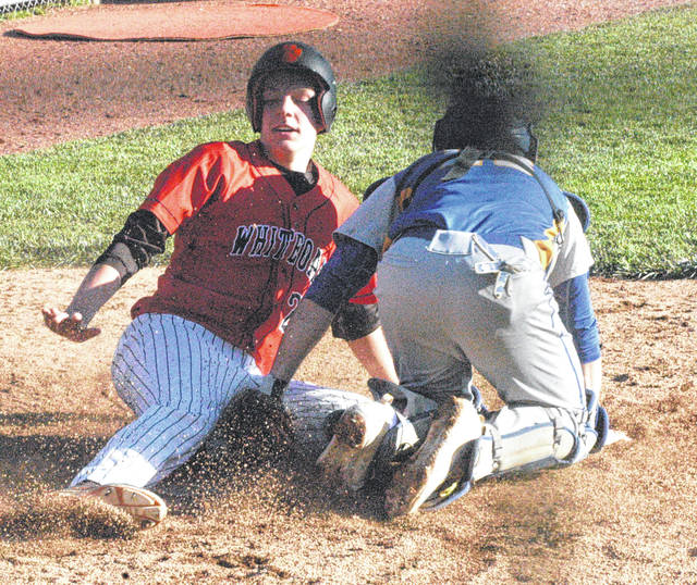 In this file photo Whiteoak junior Evan Brill slides into home plate at Whiteoak High School in a game against the Manchester Greyhounds during the 2017 season.