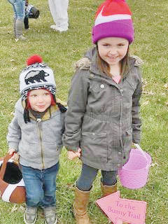 Rylee Stevenson leads her little brother, Carson Cockerill, down the Edgewood Manor Bunny Trail during an annual Community Easter Egg Hunt the facility hosted in Greenfield on March 24.
