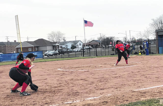 Fairfield junior Kaiti White releases a pitch while Lauren Arnold (far left foreground), Audrey Oder (far left background) and Lyndee Spargur (far right) prepare to make a play in the infield.