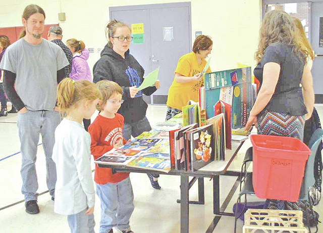 On Thursday, March 15, Lynchburg-Clay Elementary School held its second annual FRED Night. FRED (Families Read Every Day) is a time for students in grades pre-K to 5 come to the school with their families to engage in various reading activities. Each grade level had a table set up that included an appropriate activity for the student to complete. Students were also provided with a book walk, a free book, snacks, family reading with an Accelerated Reader Test and a book basket raffle. Elaine Williams, from the Lynchburg library, was also able to share what the library has to offer to students and their families. The spring Scholastic Book Fair was also open for the families to shop.